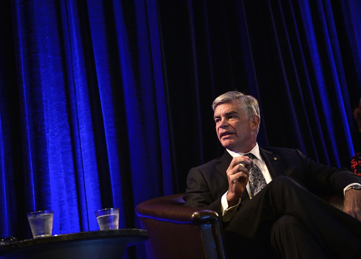 Fed's Patrick Harker Urges Go-Slow on Rate Hikes, Charles Evans Eyes Tightening