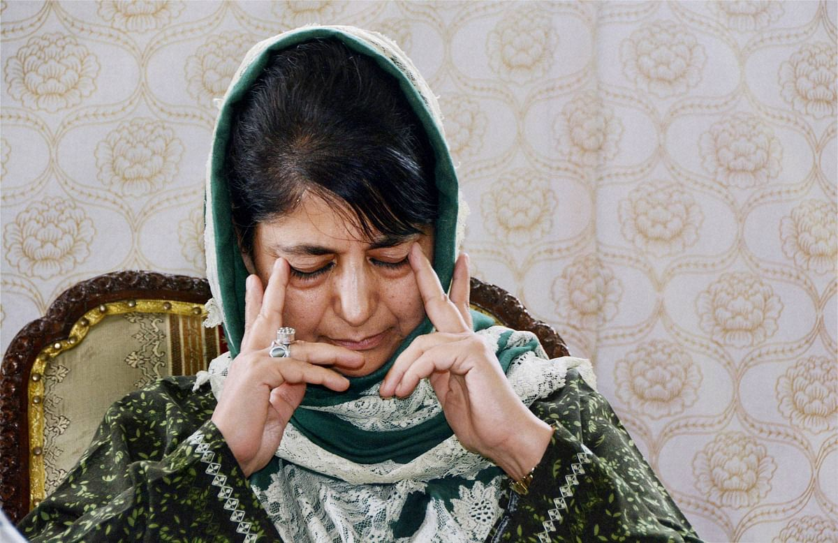Then Jammu and Kashmir Chief Minister Mehbooba Mufti reacts at a press conference in Srinagar. (Photograph: PTI)