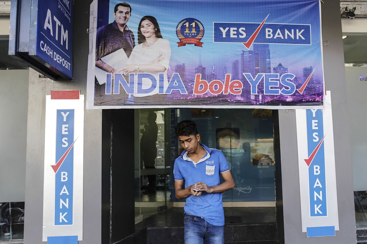 A customer exits a Yes Bank Ltd. automated teller machine (ATM) in  Ahmedabad. (Photographer: Dhiraj Singh/Bloomberg)