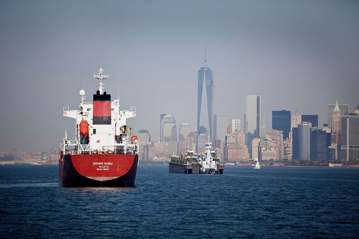 A chemical and oil tanker, left, and a barge, sit anchored in New York Harbor in New York. (Photographer: Ramin Talaie/Bloomberg)