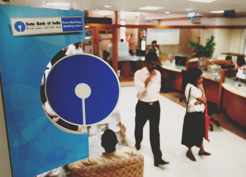 Record $1 Billion Loss Signals `Happy Year' for India's SBI
