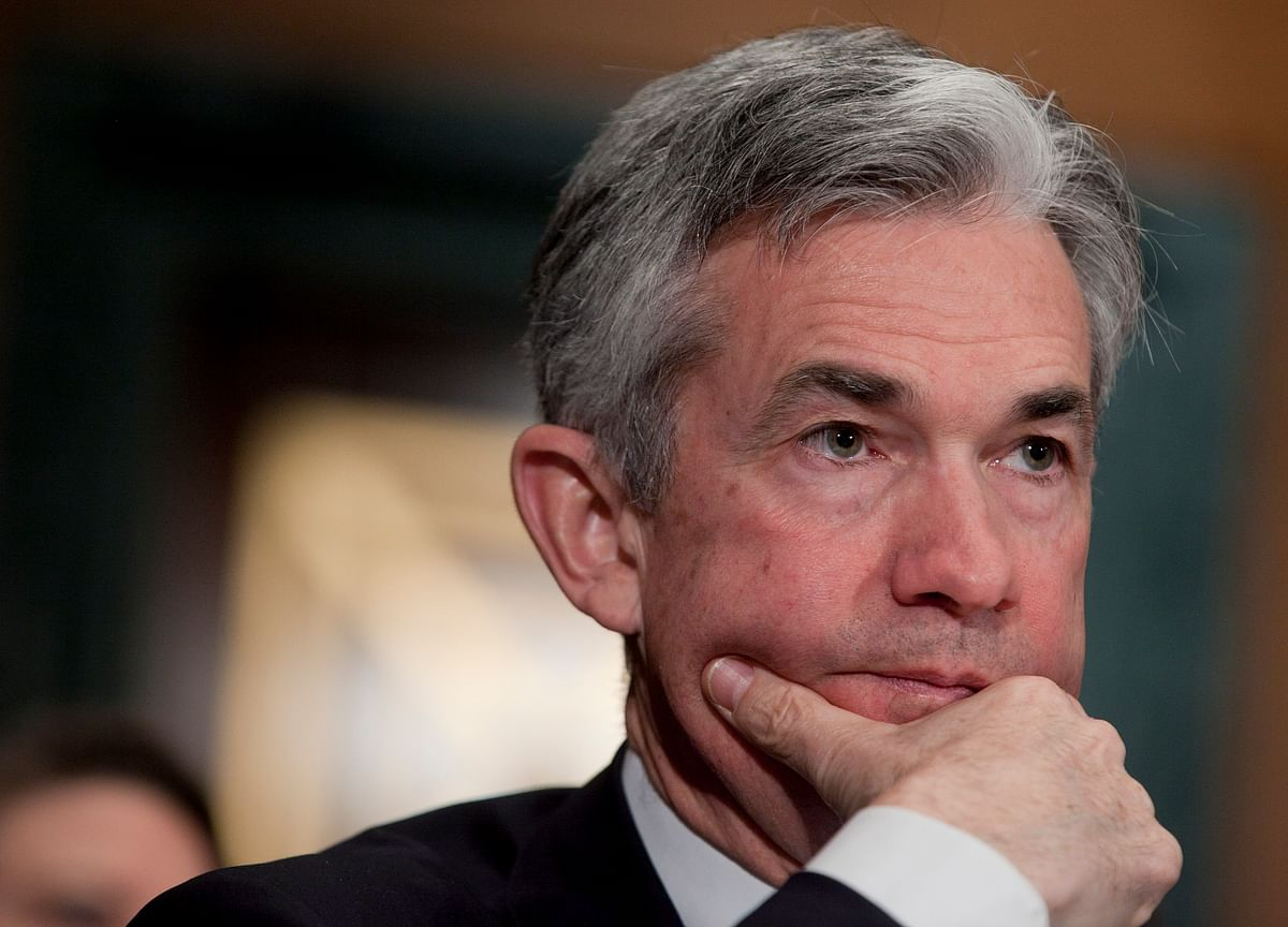 Powell's 'Just Below'Comment Seen as Suggesting Fewer Hikes