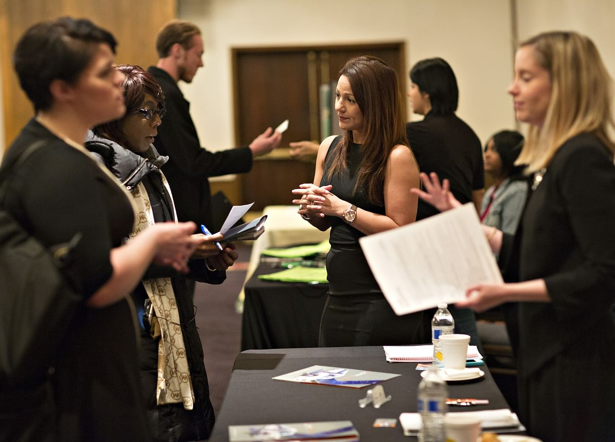 U.S. Hiring Resilient With 128,000 Gain, Validating Fed Pause