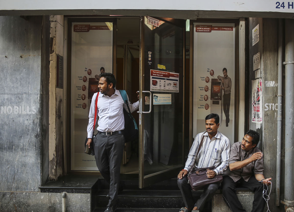 Fitch Downgrades ICICI Bank, Axis Bank Ratings Amid Banking Stress
