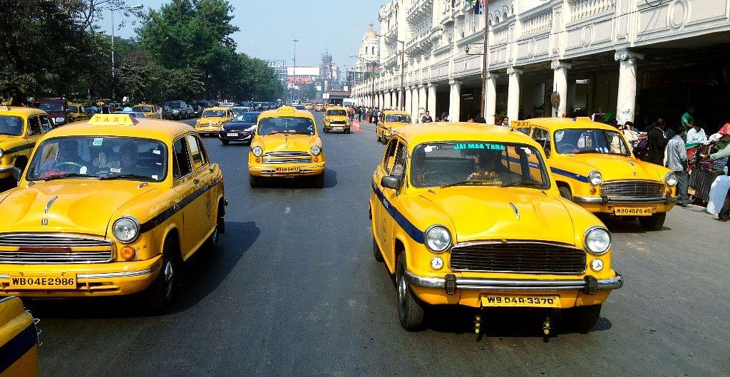 "Ambassador taxis in Calcutta, India. (Source: <a href=""https://www.flickr.com/photos/ashleycoates/"">Ashley Coates</a>/ Flickr)"