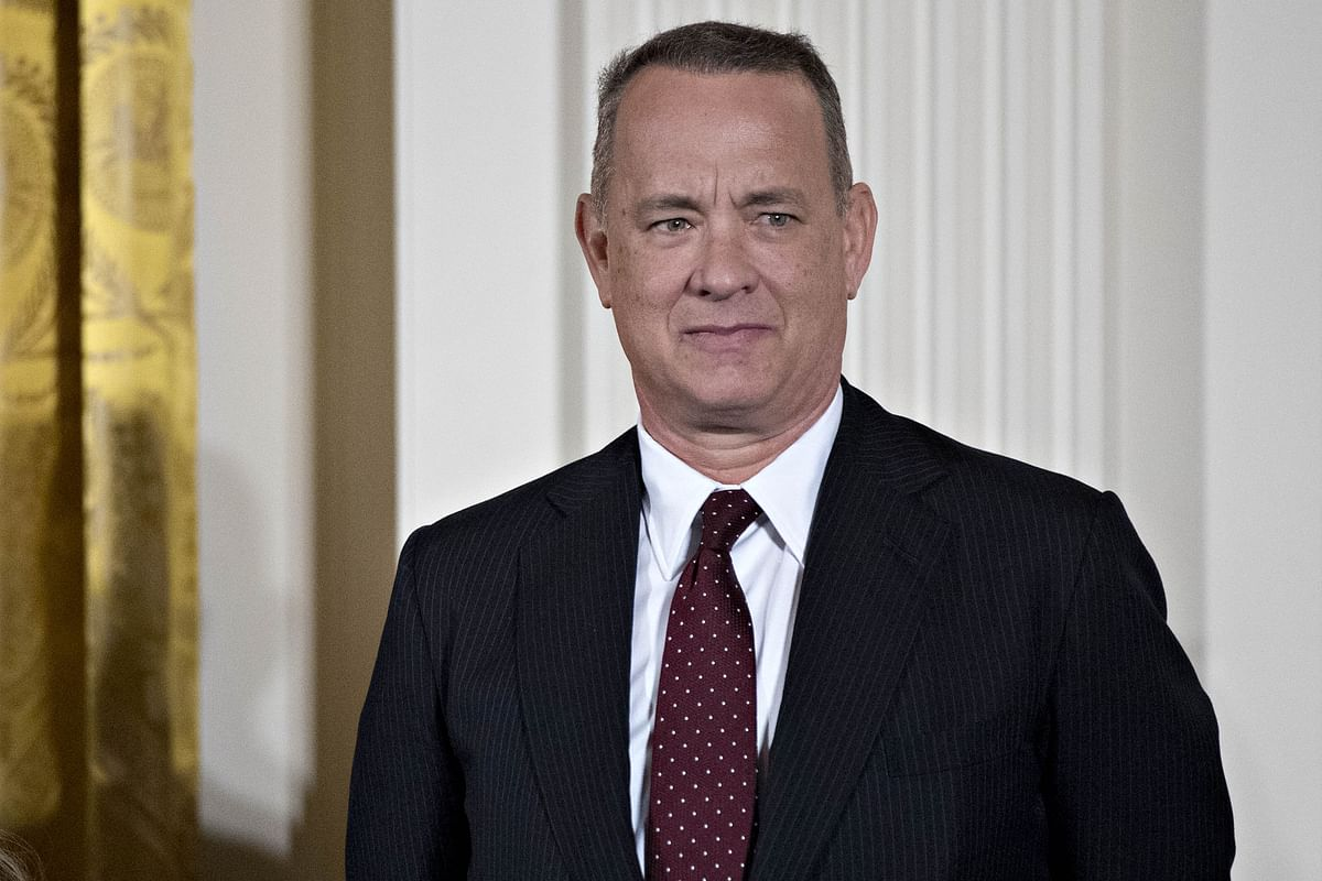 Actor Tom Hanks arrives to a Presidential Medal of Freedom ceremony in the East Room of the White House in Washington. (Photographer: Andrew Harrer/Bloomberg)