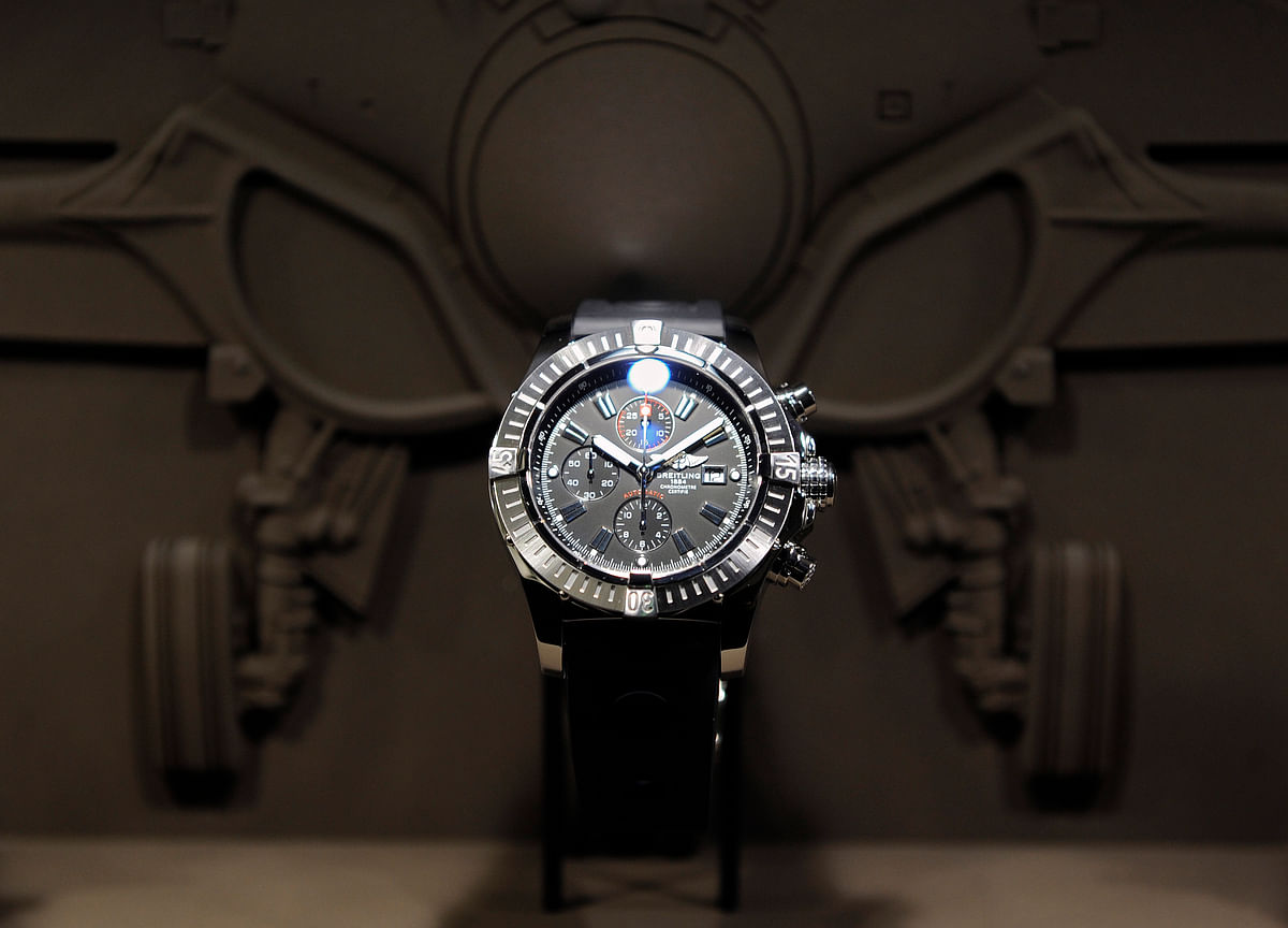 Travolta's Swiss Watchmaker Breitling Agrees to Sell to CVC