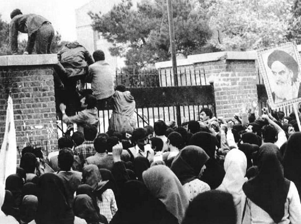 Iranian students scale the gates of the U.S. embassy in Tehran on November 4, 1979. (Photograph: Wikimedia Commons)