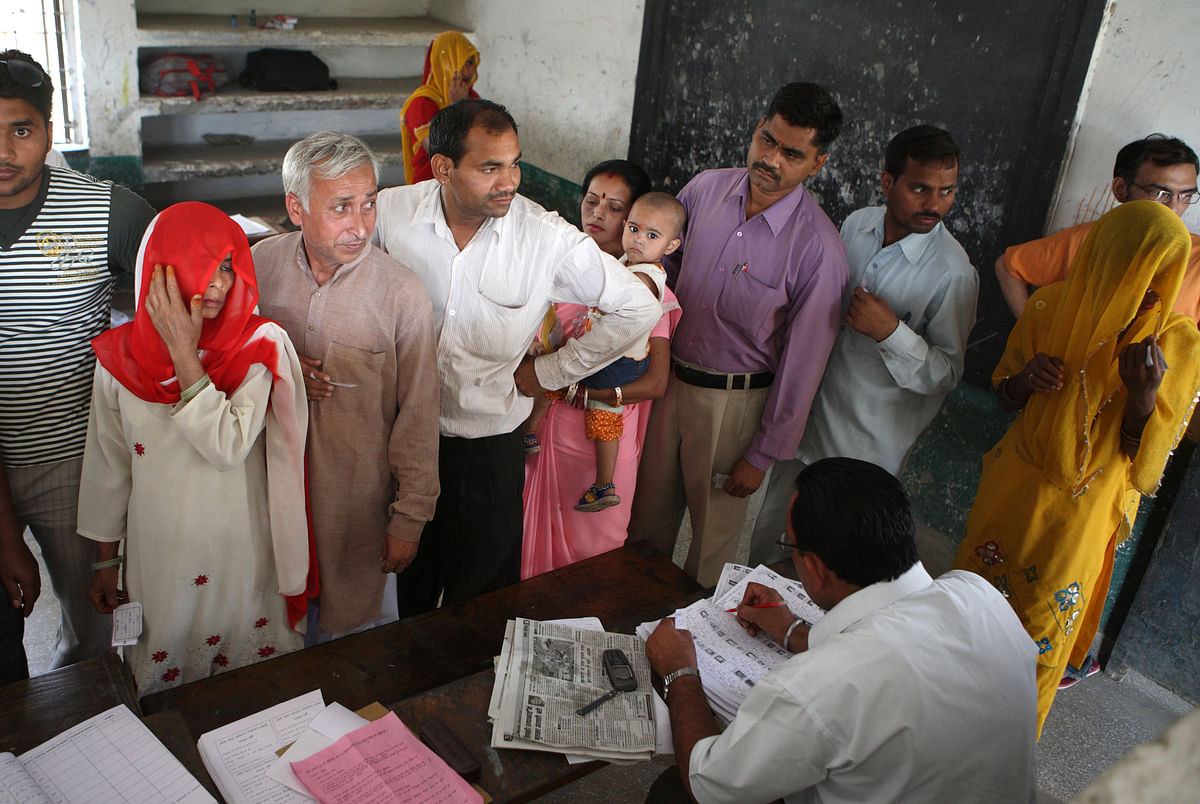 Indian voters register to get their polling slips in Ghaziabad, India. (Photographer: Pankaj Nangia/Bloomberg News)