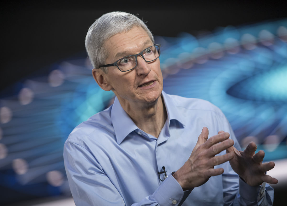 Apple CEO Cook Urges China to Keep Opening Up Its Economy