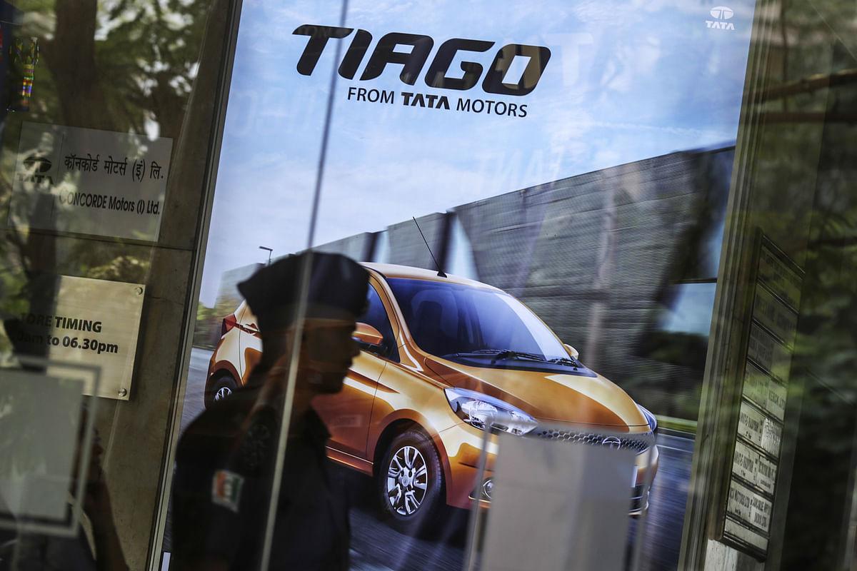 An advertisement for the Tata Motors Ltd. Tiago hatchback is displayed inside the Prabhadevi Concorde Motors India Ltd. dealership in Mumbai, India. (Photographer: Dhiraj Singh/Bloomberg)