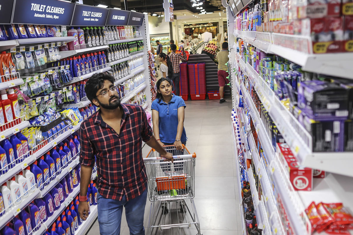 Shoppers browse household goods at a hypermarket. (Photographer: Dhiraj Singh/Bloomberg)