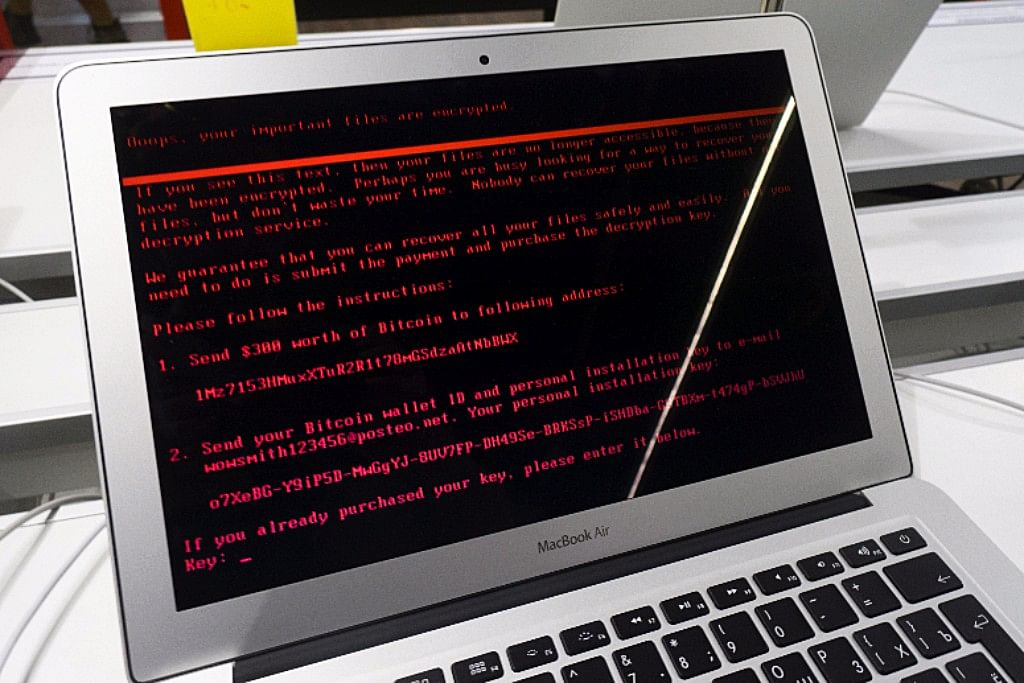 A ransomware demand  sits on the screen of an Apple Inc. Macbook Air laptop infected by the 'Petya' computer virus inside an electronics store in Kiev, Ukraine ((Photographer: Vincent Mundy/Bloomberg)