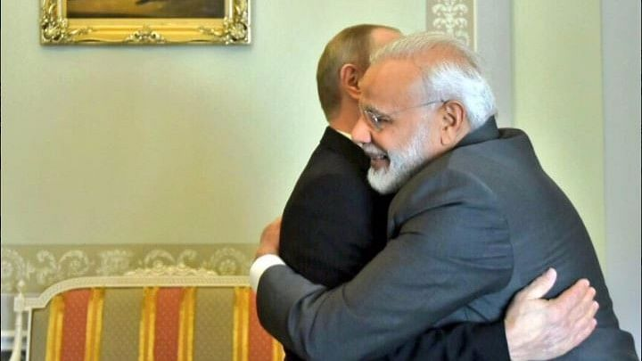 "PM Modi gives Vladimir Putin one of his famous hugs. (Photo Courtesy: <a href=""https://twitter.com/MEAIndia"">Twitter</a>)"