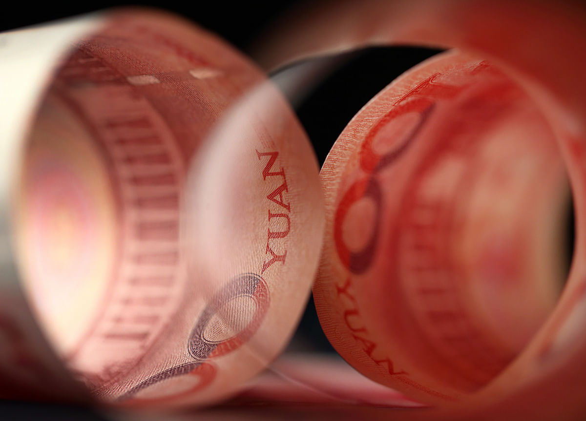 China Is Saving Stimulus for Trade War Winter as Yuan Weakens