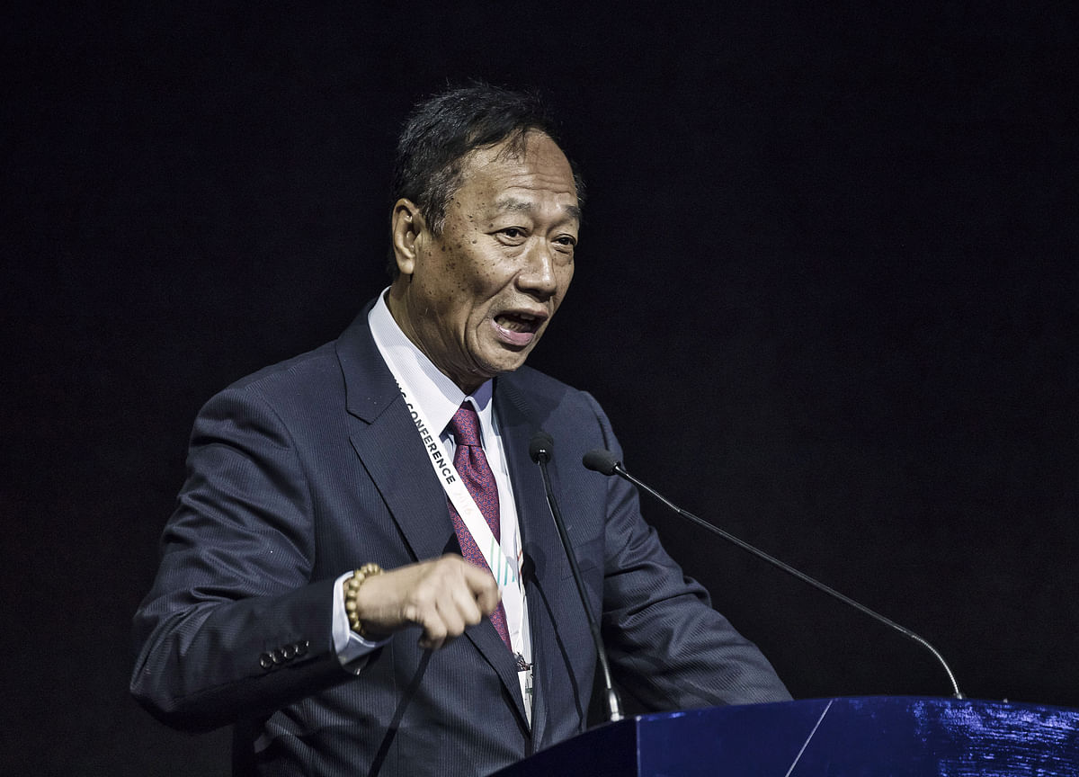 Foxconn's Billionaire Founder Urges Apple to Invest in Taiwan