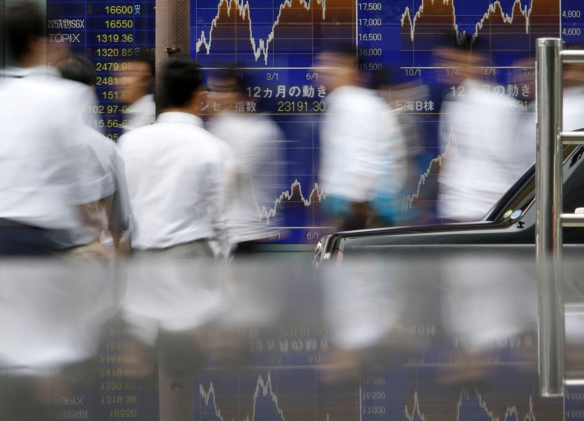 Stocks Lower as Fed Takes Slightly Hawkish Tone: Markets Wrap