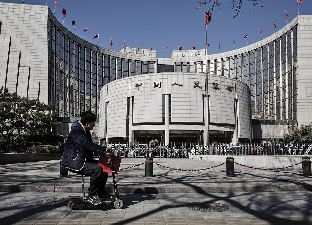 China Quietly Cuts Borrowing Costs While Keeping Rates on Hold