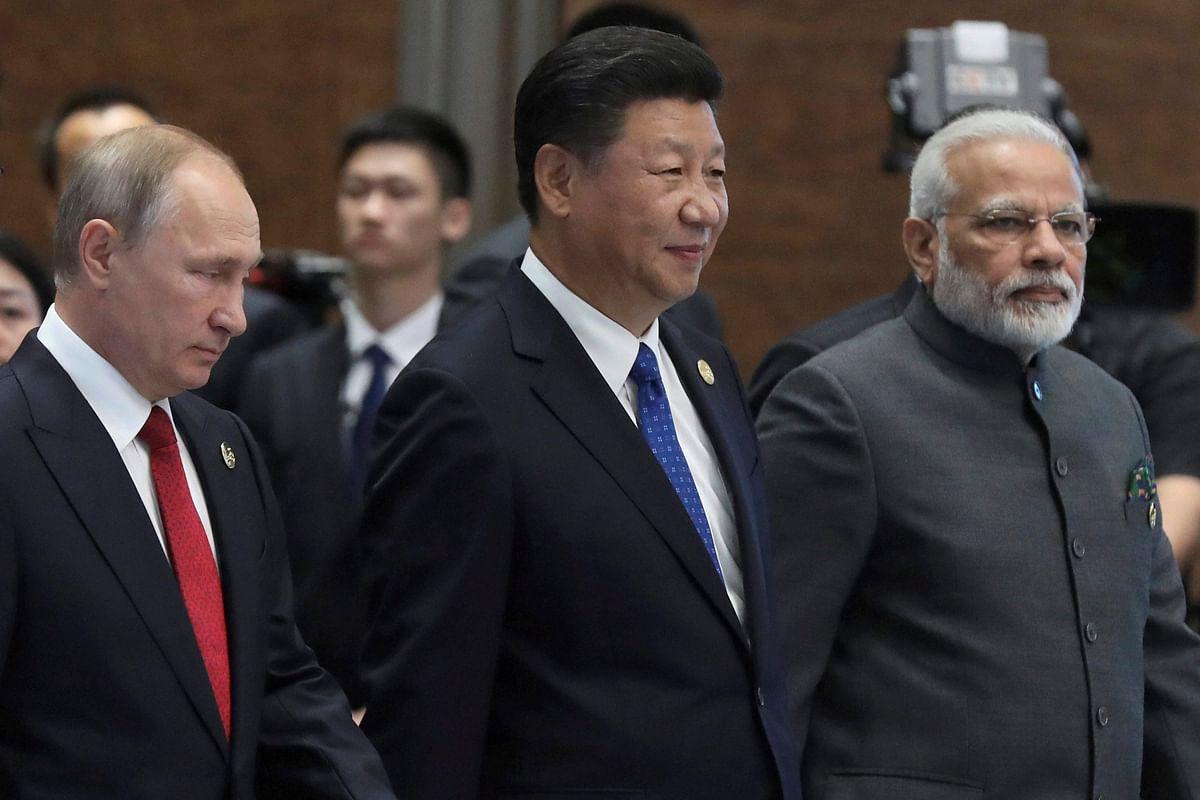 Vladimir Putin, Xi Jinping and Narendra Modi on the sideline of the BRICS Summit in Xiamen, China. (Photograph: PTI)