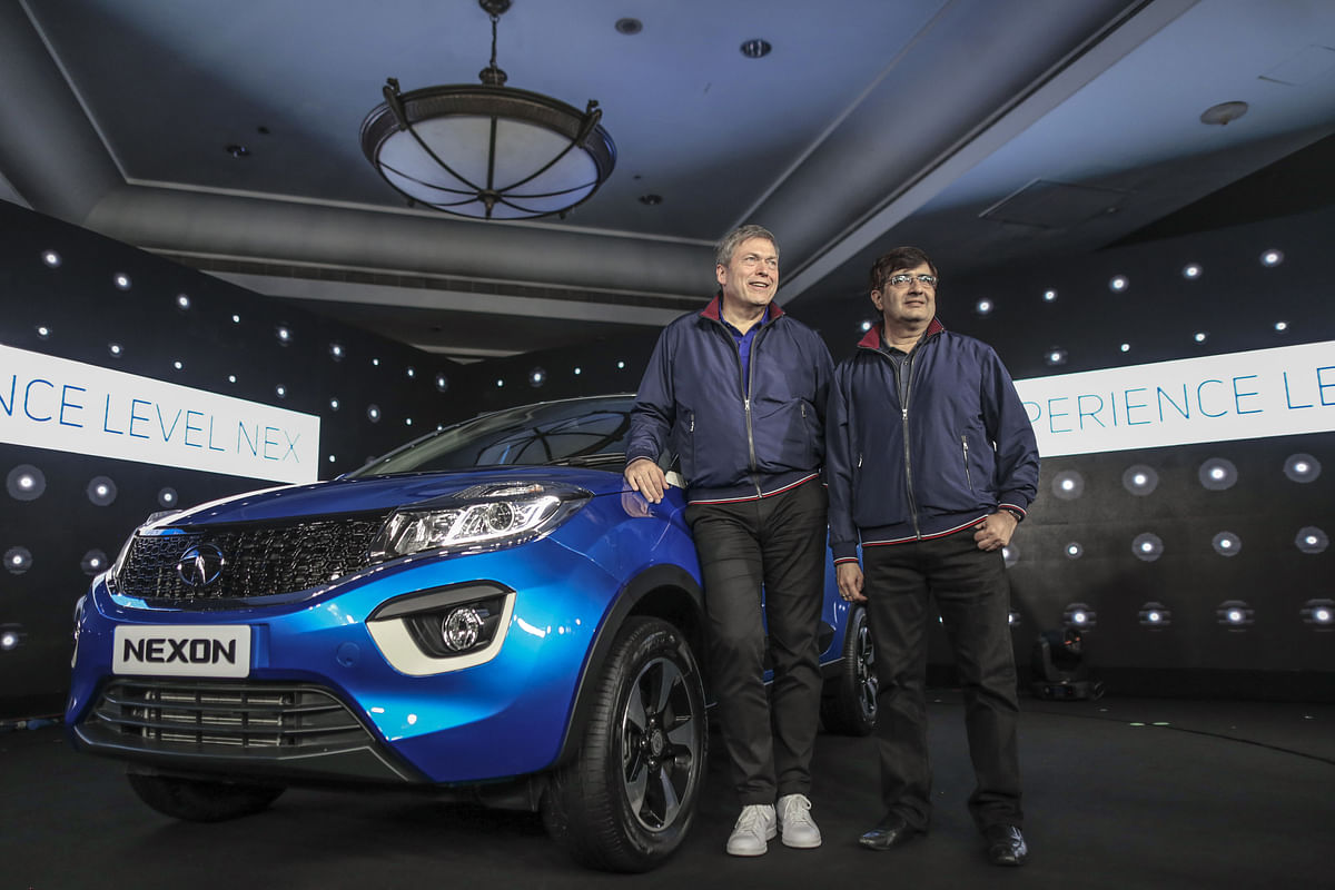 Guenter Butschek, chief executive officer of Tata Motors Ltd., left, and Mayank Pareek, president of passenger vehicles at Tata Motors (Photographer: Dhiraj Singh/Bloomberg)