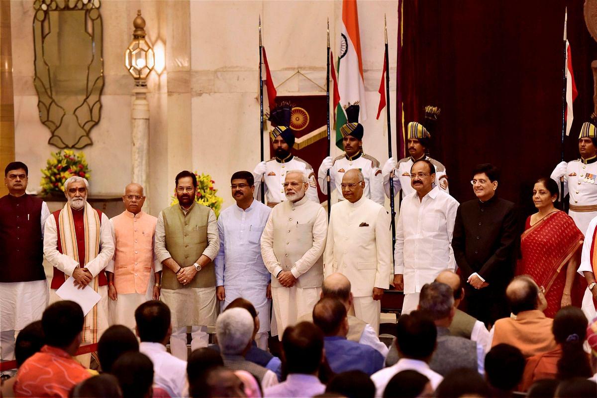 President Ram Nath Kovind, Vice President M. Venkaiah Naidu, Prime Minister Narendra Modi poses with some new members of cabinet after the reshuffle at Rashtrapati Bhavan in New Delhi on Sunday. (Photographer: Kamal Kishore/PTI)