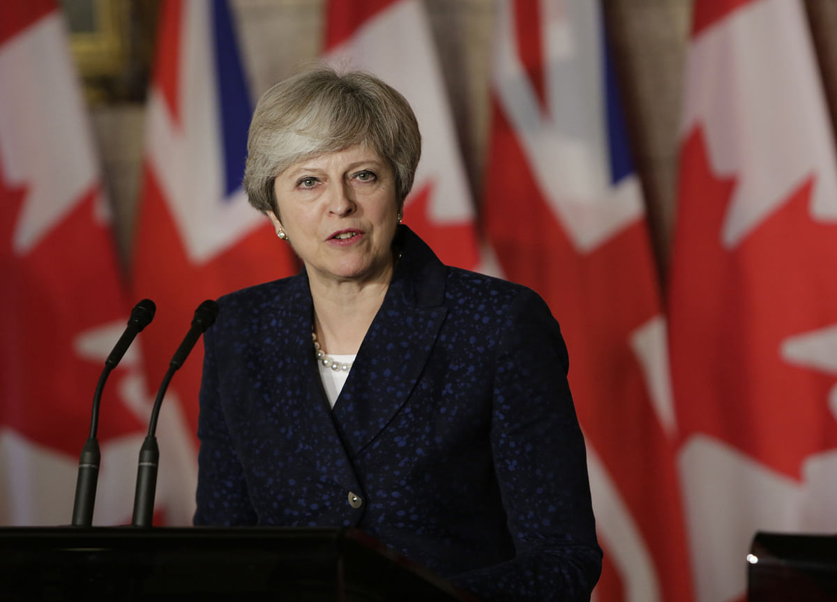 May Needs a Smooth U.K. Budget as Conservatives Seek Revival