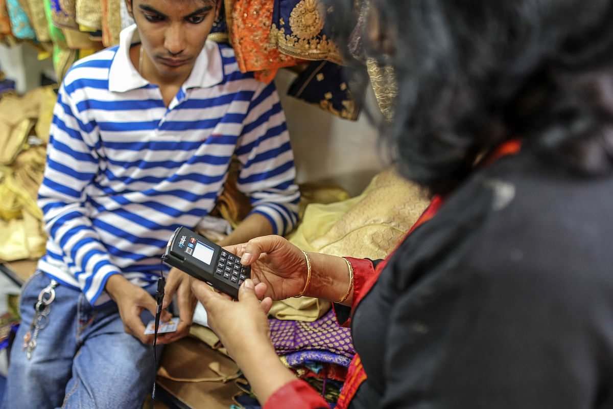 A customer uses an Mswipe terminal, operated by M-Swipe Technologies Pvt Ltd., at a clothing store (Photographer: Dhiraj Singh/Bloomberg)
