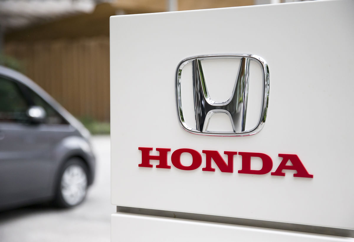 The Honda Motor Co. logo is displayed outside the venue for a media preview of the N-Box minicar in Tokyo, Japan. (Photographer: Tomohiro Ohsumi/Bloomberg)