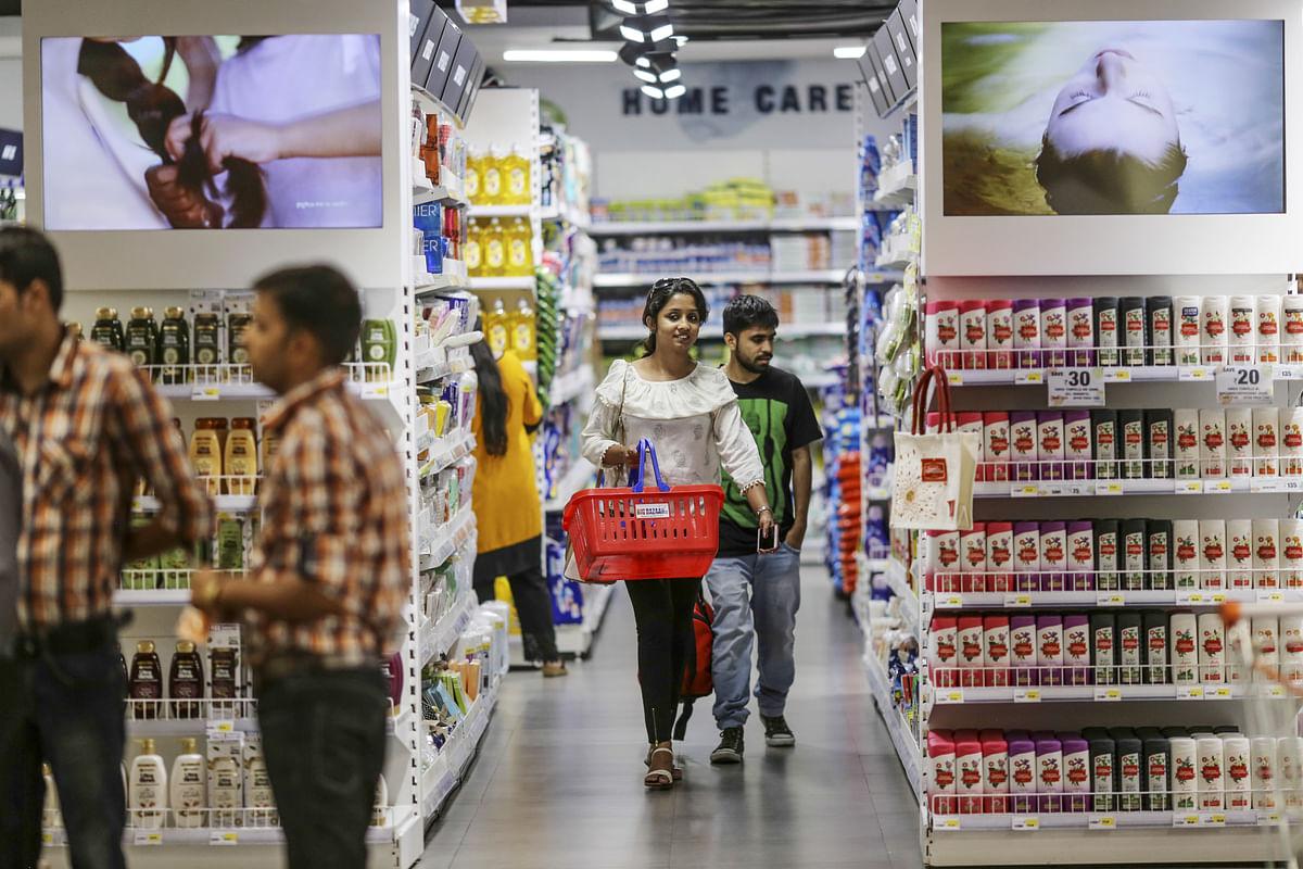 Customers browse household goods at a Big Bazaar hypermarket. (Photographer: Dhiraj Singh/Bloomberg)