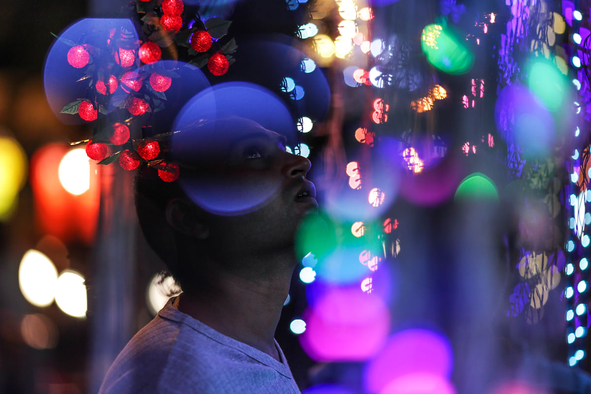 A customer looks at strings of light-emitting diodes (LED) at an electronics store during the festival of Dhanteras in the Dadar market area of Mumbai, India (Photographer: Dhiraj Singh/Bloomberg)