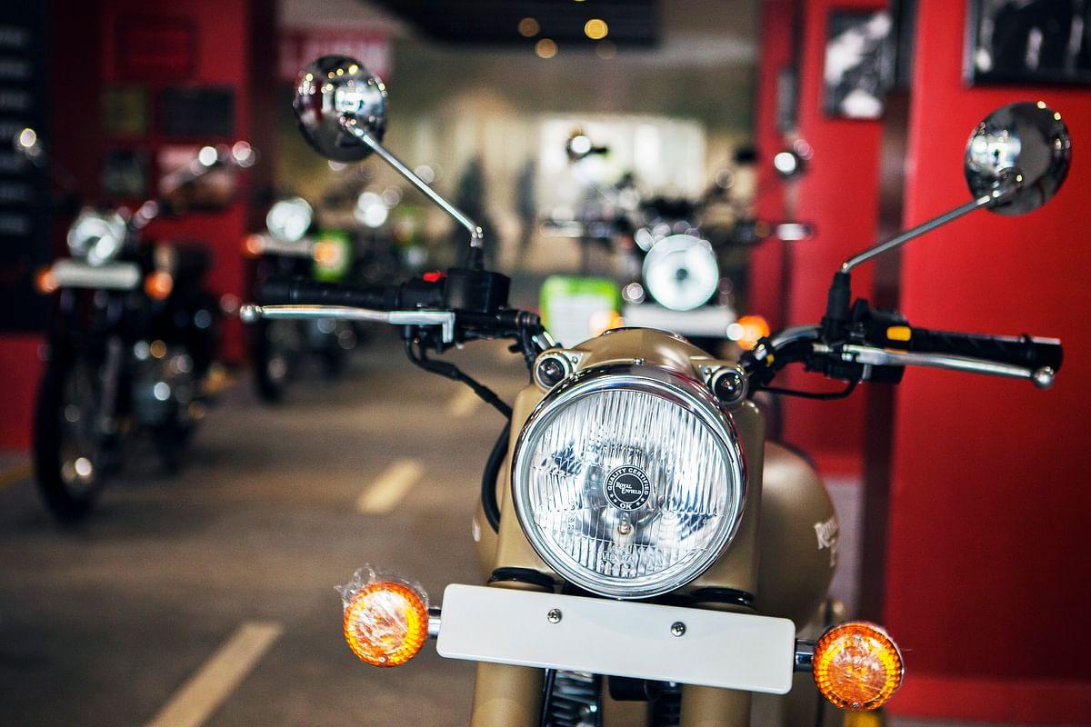 An Eicher Motors Ltd. Royal Enfield Desert Storm motorcycle stands on display at the company's Royal Enfield flagship dealership in Gurgaon, India (Photographer: Prashanth Vishwanathan/Bloomberg)