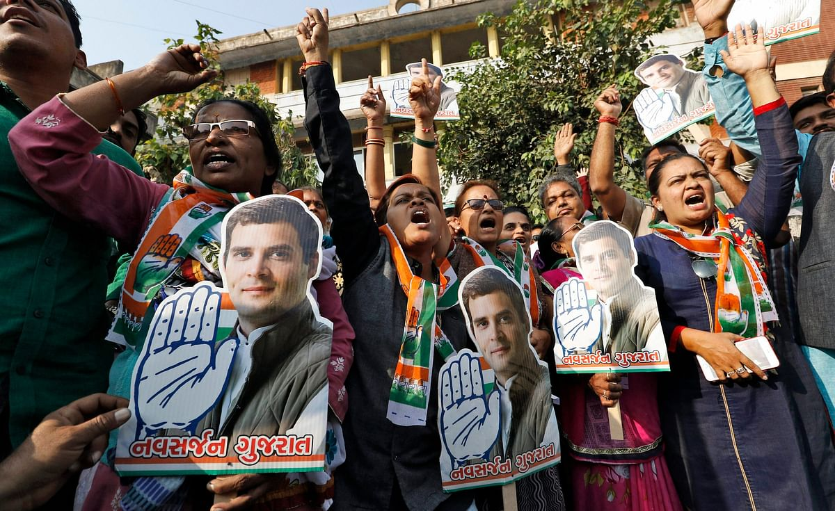 Congress party supporters hold a cut-out of newly appointed party chief Rahul Gandhi, in Ahmedabad on December 16, 2017. (Photograph: PTI)