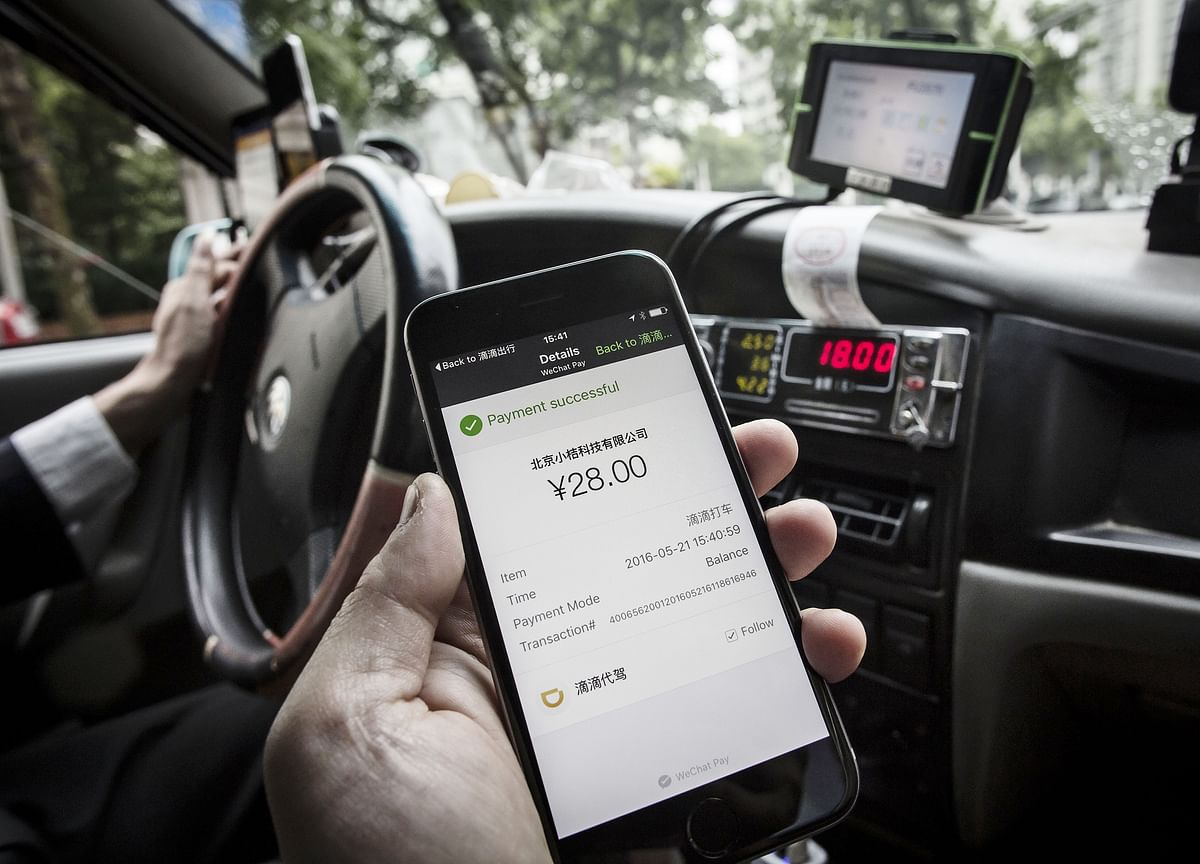 China's Didi Cashes Up to Go Global in Next Stage of Uber Battle