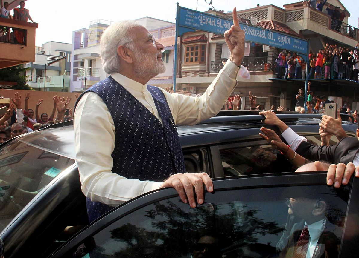 Modi Stands In Queue To Cast Vote; Election Commission Orders Inquiry On Congress' Complaint