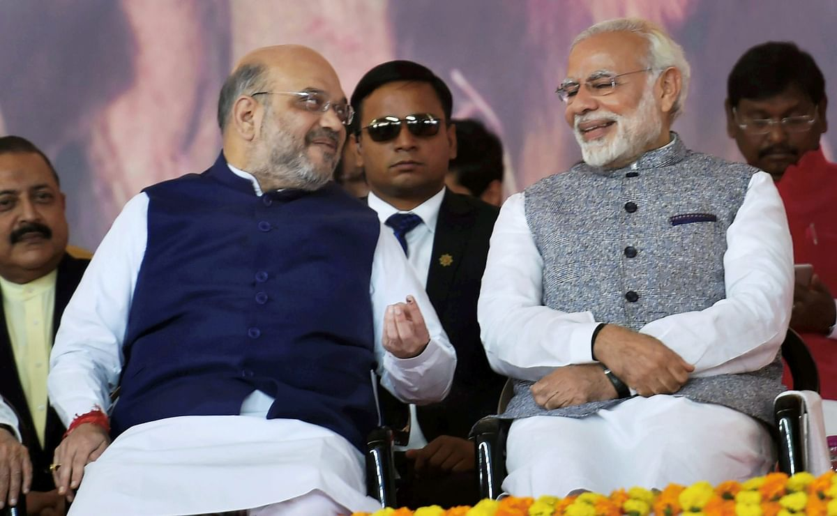 Prime Minister Narendra Modi and BJP President Amit Shah during the swearing-in ceremony of the new Gujarat government in Gandhinagar on December 27, 2017, (Photographer: Santosh Hirlekar/PTI)