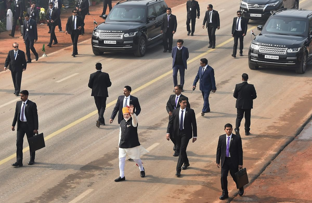 Prime Minister Narendra Modi waves at the crowd during the 69th Republic Day Parade at Rajpath. (Image: PTI)