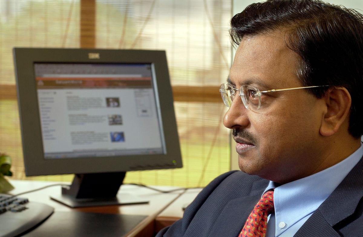 Satyam Computers Chairman, Ramalinga Raju, speaks to Bloomberg in his Singapore office Thursday, February 27, 2003. (Photographer: Munshi Ahmed/Bloomberg News)