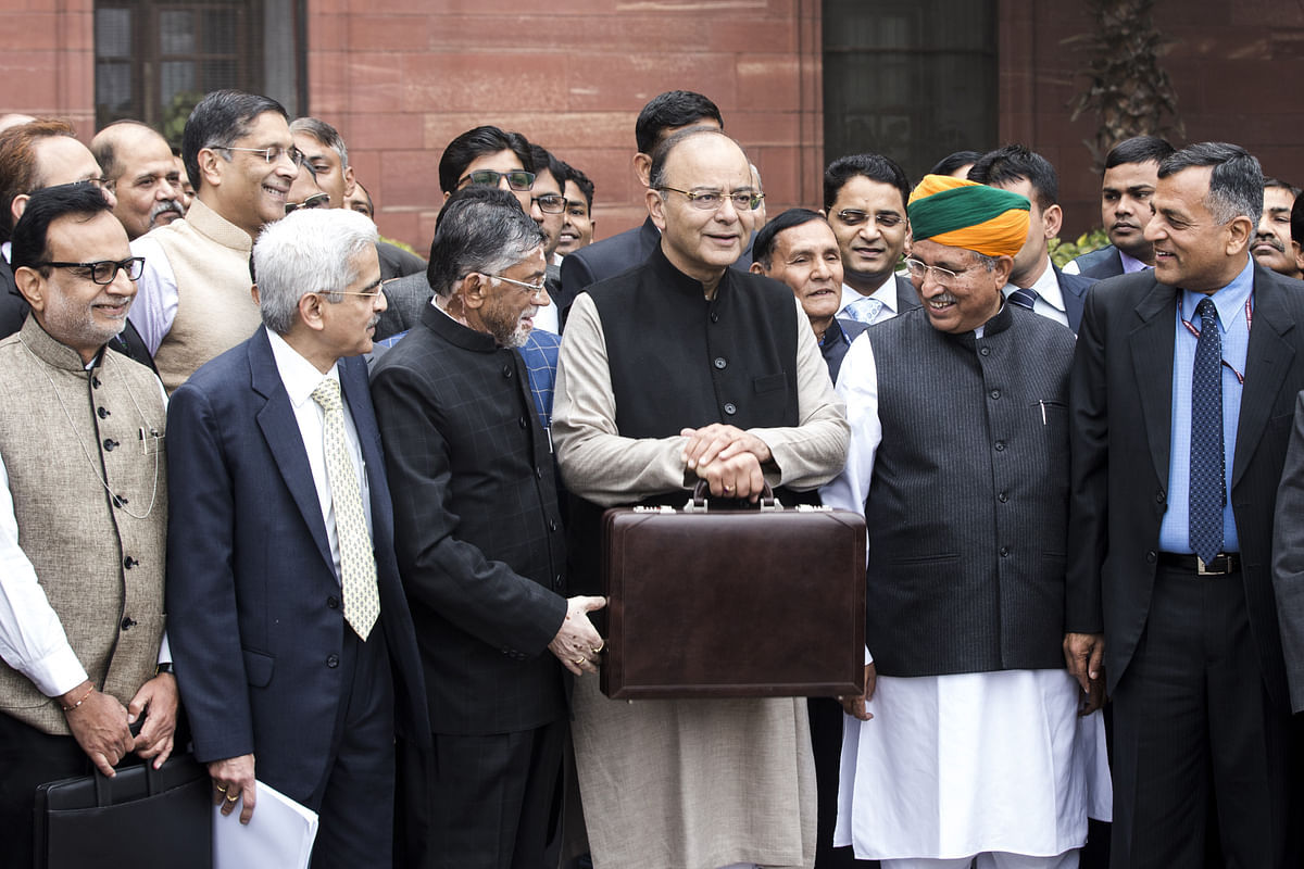 Arun Jaitley, India's finance minister, center left, and other members of the finance ministry stand for a photograph outside the North Block of the Central Secretariat building before leaving to table the budget in parliament in New Delhi. (Photographer: Udit Kulshrestha/Bloomberg)