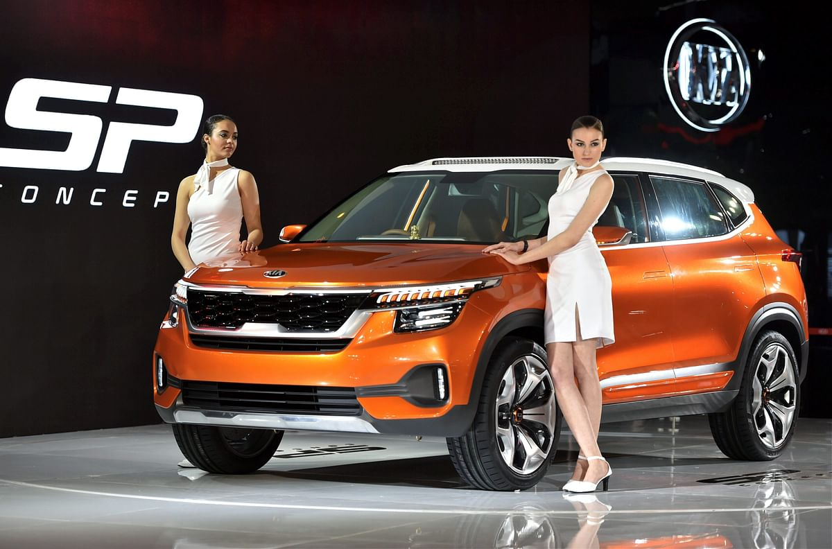 Models showcase a Kia Motors Corporation's SP Concept car at the Auto Expo 2018 in Greater Noida on Wednesday. (Source: PTI)