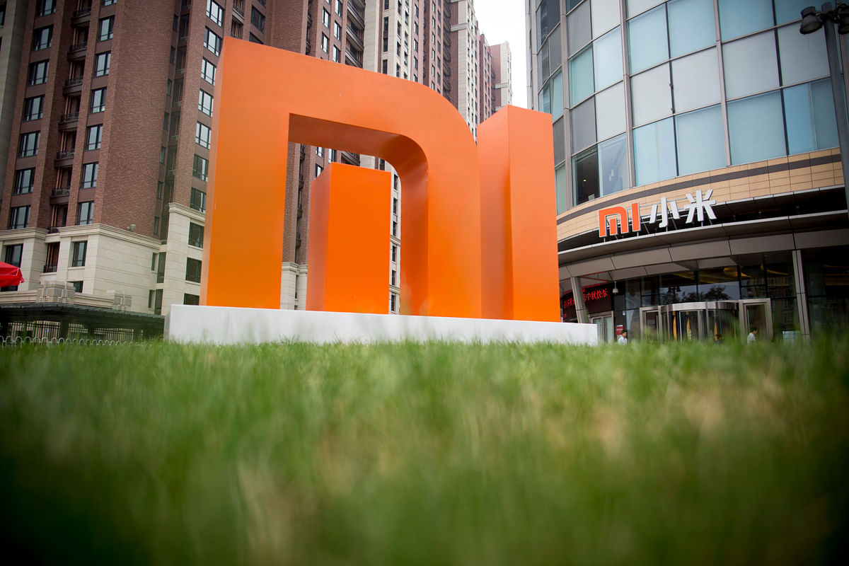 The Xiaomi Corp. logo stands outside the company's headquarters in Beijing, China. (Photographer: Brent Lewin/Bloomberg)