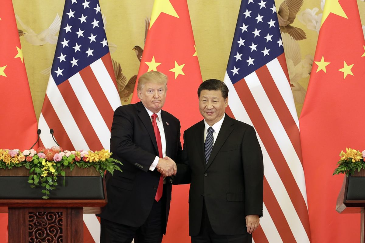 FILE: U.S. President Donald Trump, left, and Xi Jinping, China's president, shake hands during a news conference  in Beijing, China, on  Nov. 9, 2017. (Photographer: Qilai Shen/Bloomberg)