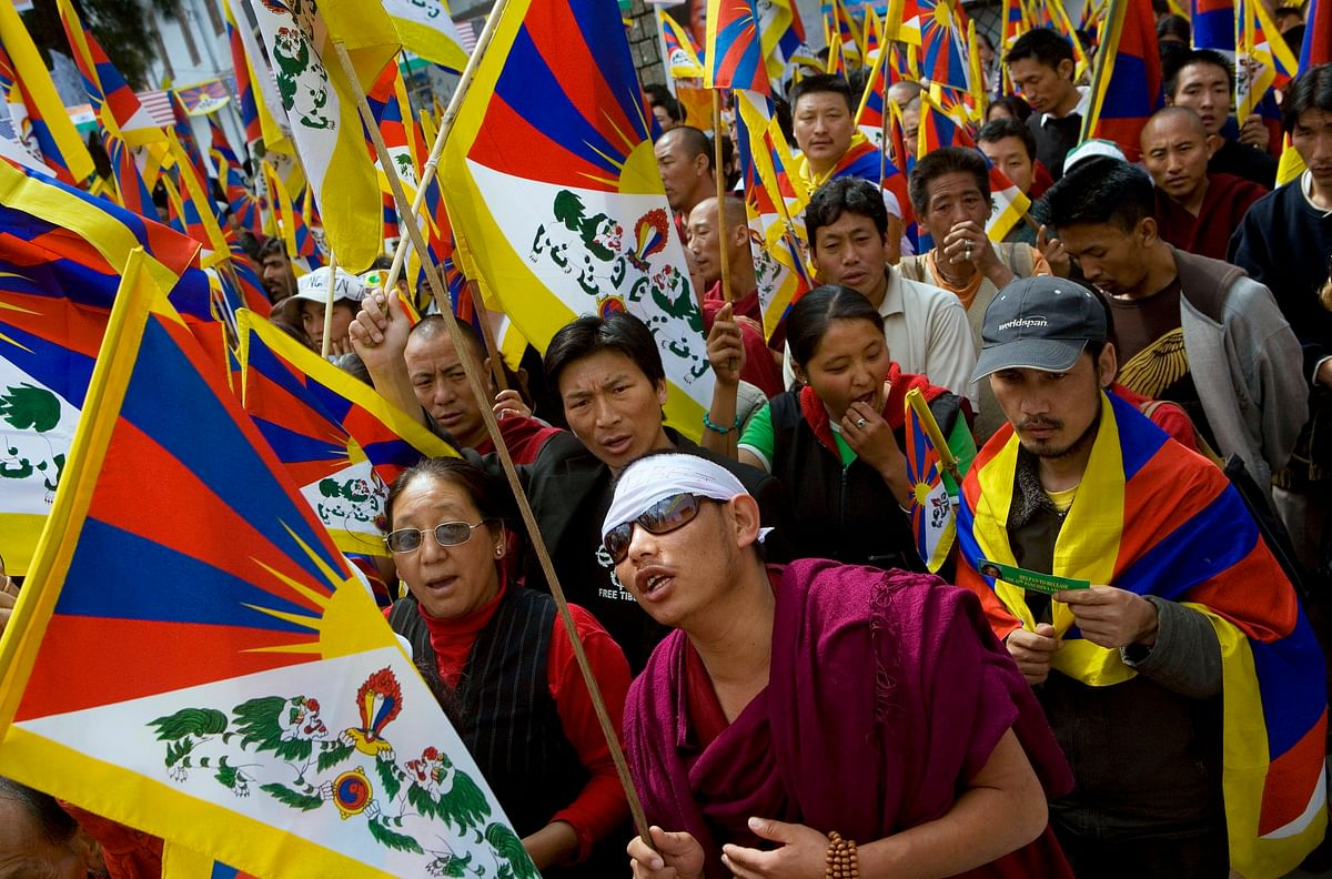 Tibetans march in protest of the Chinese occupation of Tibet, in Dharamsala, India, on March 22, 2008. (Photographer: Adam Ferguson/Bloomberg News)
