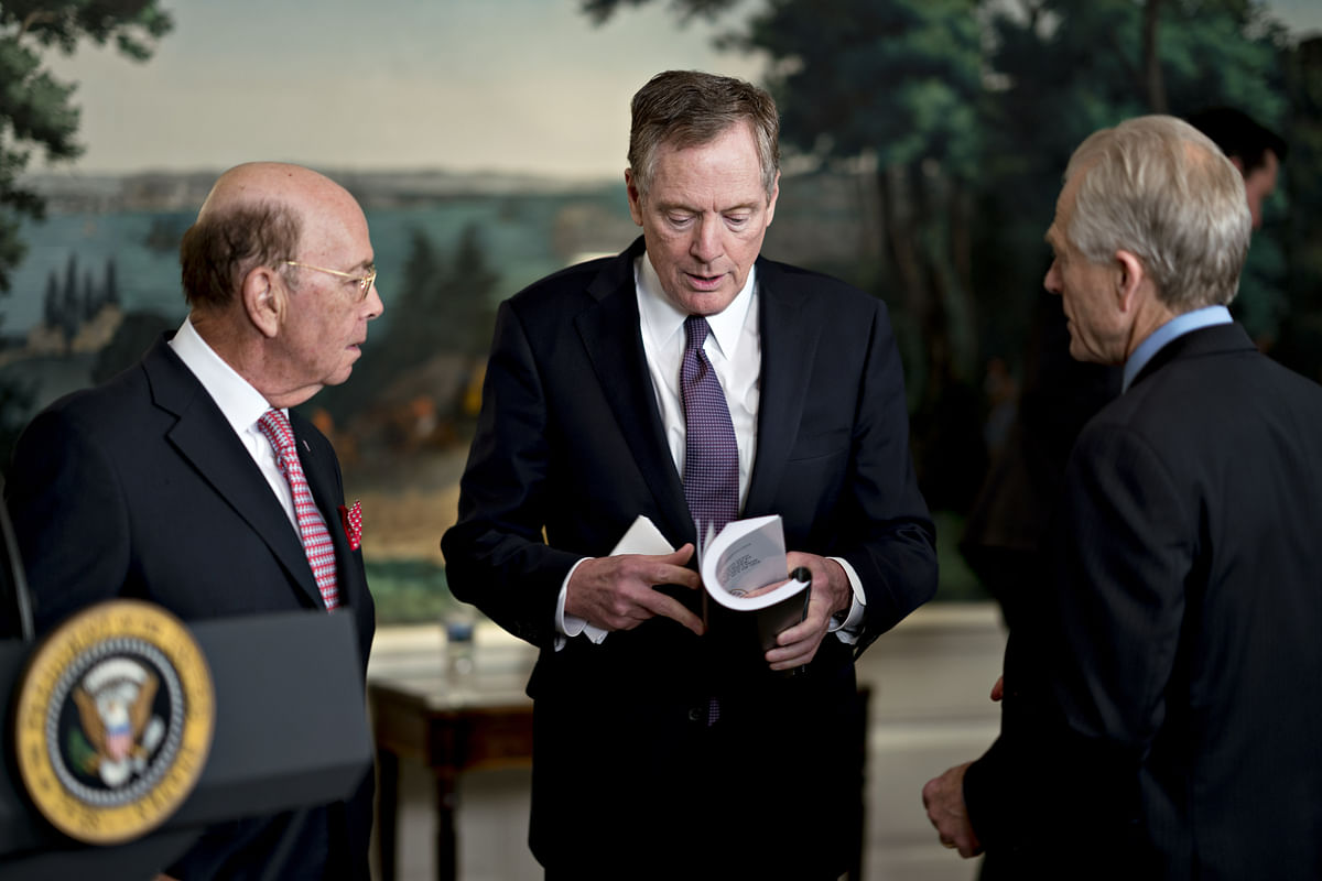 Peter Navarro, director of the National Trade Council, from right, Robert Lighthizer, U.S. trade representative, and Wilbur Ross, U.S. commerce secretary, speak before U.S. President Donald Trump, not pictured, signs a presidential memorandum targeting China's economic aggression in the Diplomatic Room of the White House in Washington, D.C., U.S., on March 22, 2018. (Photographer: Andrew Harrer/Bloomberg)
