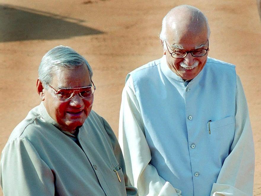 Atal Bihari Vajpayee and  LK Advani, in New Delhi, on Oct.  13, 2003. (Photographer: Sondeep Shankar/Bloomberg News)