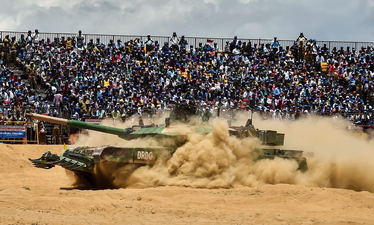 An Indian Arjun Mark II tank drives through the sand during a live demo for the public. (Source: PTI)