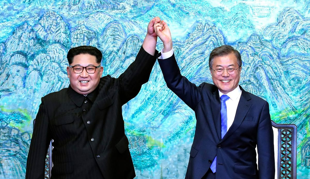 Kim Jong Un, North Korea's leader,  with Moon Jae-in, South Korea's president, at the inter-Korean summit outside the Peace House in the village of Panmunjom in the Demilitarized Zone (DMZ) in Paju, South Korea, on April 27, 2018. (Photograph: AP/PTI)