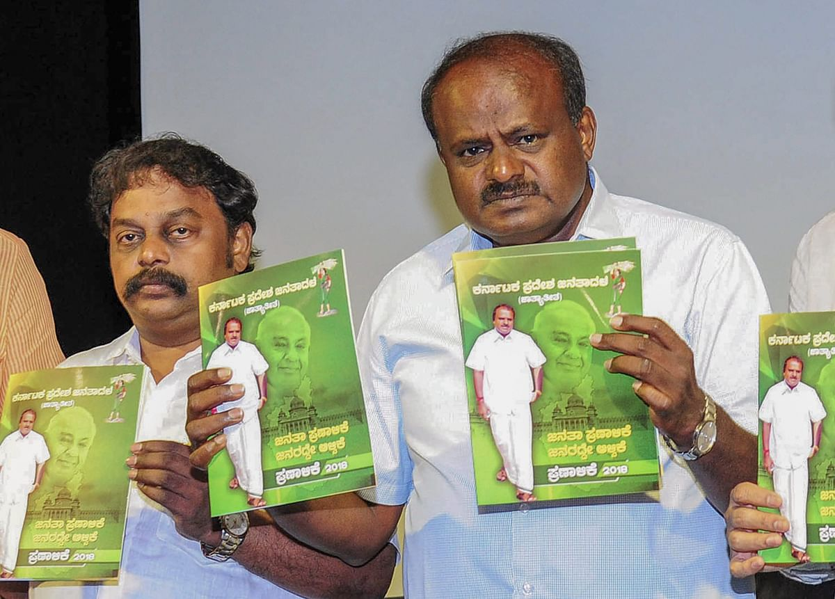 Janata Dal (Secular) President HD Kumaraswamy with party leaders release a party manifesto ahead of Karnataka Assembly Elections. (Source: PTI)