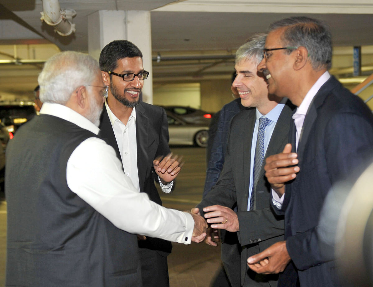 """Prime Minister Narendra Modi meets Google co-founder Larry page, and CEO Sundar Pichai, at the Google-Alphabet campus, in Silicon Valley, California on September 27, 2015. (Photograph: PIB)<a href=""""https://www.facebook.com/sharer/sharer.php?u=http://pibphoto.nic.in/photo//2015/Sep/l2015092871326.jpg""""><i><br></i></a>"""