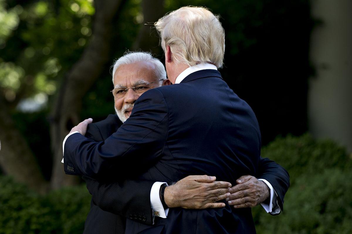 Narendra Modi, India's prime minister, hugs U.S. President Donald Trump in the Rose Garden of the White House in Washington, D.C., U.S., on  June 26, 2017. (Photographer: Andrew Harrer/Bloomberg)