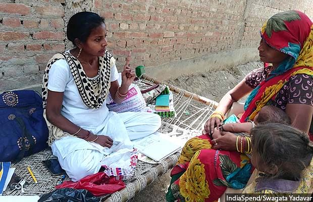 ANM Archana counselling a mother after immunisation at Badnamo village in Farrukhabad district in central Uttar Pradesh.